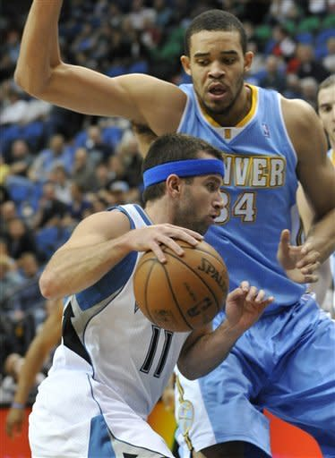 Minnesota Timberwolves' J.J. Barea, left, drives past Denver Nuggets' JaVale McGee during the first half of an NBA basketball game Thursday, April 26, 2012, in Minneapolis. (AP Photo/Jim Mone)