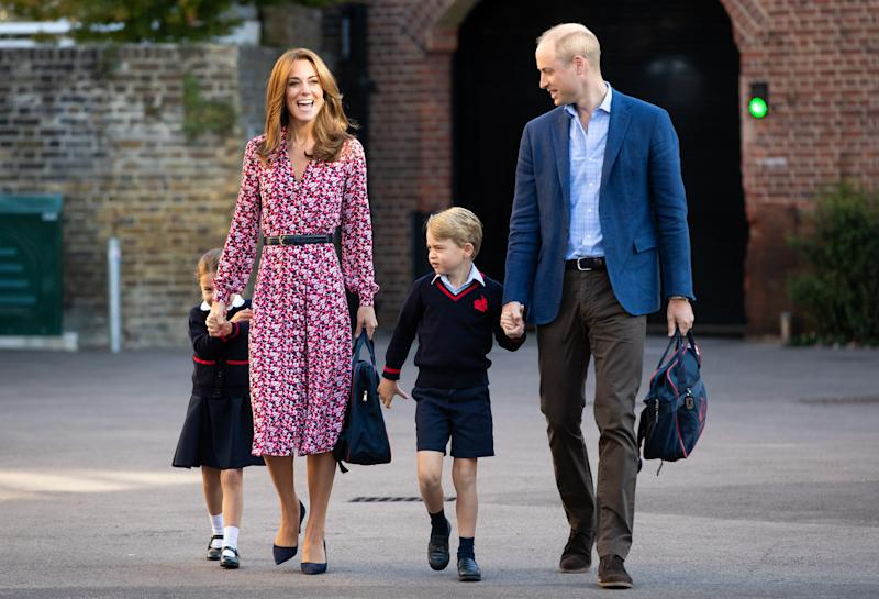 The belted dress she wore to bring Princess Charlotte to her first day of school is by Michael Kors.