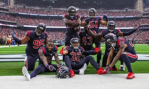 <span>The Texans defense celebrates after Andre Hal picks off Baker Mayfield in the second quarter</span> <span>Credit: John Glaser/USA TODAY </span>
