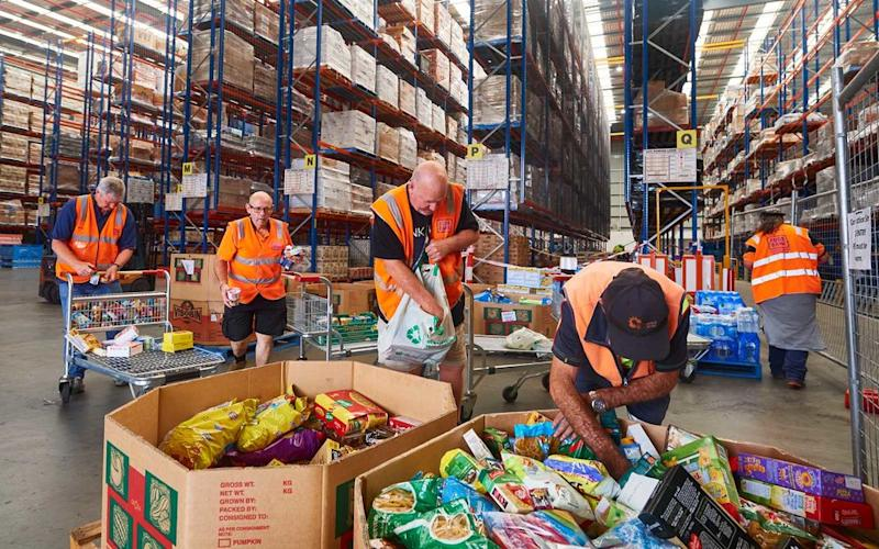 Volunteers help help organise large donations of goods at the Food Bank Distribution Centre bound for areas impacted by bushfires on January 07, 2020 in the Glendenning suburb of Sydney, Australia.   Brett Hemmings/Getty Images