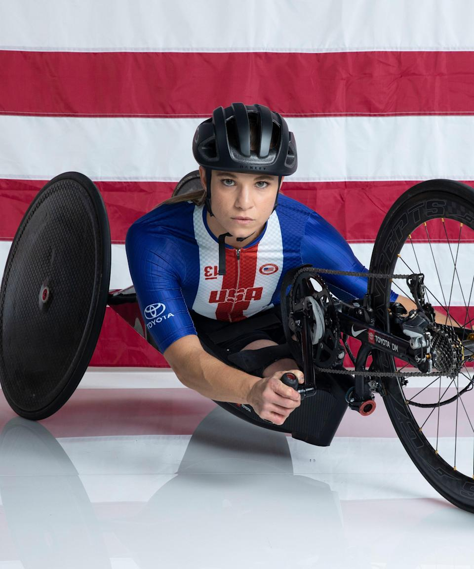 """<strong><h2>Oksana Masters </h2>Sport: </strong>Road Cycling<br><strong>Instagram: </strong><a href=""""https://www.instagram.com/oksanamasters/?hl=en"""" rel=""""nofollow noopener"""" target=""""_blank"""" data-ylk=""""slk:@oksanamasters"""" class=""""link rapid-noclick-resp"""">@oksanamasters</a> <br><br>Masters is a four-time Paralympian and eight-time medalist. Originally from Ukraine, she's been diagnosed with <a href=""""https://orthoinfo.aaos.org/en/diseases--conditions/tibial-hemimelia/"""" rel=""""nofollow noopener"""" target=""""_blank"""" data-ylk=""""slk:tibial hemimelia"""" class=""""link rapid-noclick-resp"""">tibial hemimelia</a> and was born with damage to both legs due to in-utero radiation poisoning after the <a href=""""https://www.refinery29.com/en-us/2019/05/231882/chernobyl-disaster-what-happened-facts-hbo-true-story"""" rel=""""nofollow noopener"""" target=""""_blank"""" data-ylk=""""slk:Chernobyl nuclear reactor incident"""" class=""""link rapid-noclick-resp"""">Chernobyl nuclear reactor incident</a>, <a href=""""https://www.teamusa.org/para-nordic-skiing/athletes/oksana-masters"""" rel=""""nofollow noopener"""" target=""""_blank"""" data-ylk=""""slk:Team USA reports"""" class=""""link rapid-noclick-resp"""">Team USA reports</a>. She was adopted by an American speech therapy professor at age 7, and at 13, she began rowing. She's gone on to compete in the biathlon, cross country skiing, and road cycling.<br><br><strong>What's your favorite workout?</strong> <br>""""Short and sweet power-speed workouts,"""" she says. She'll go for intervals of 10 minutes, three times in a row. During each interval, she'll mix up the pace, doing 45 seconds of all-out effort, then 15 seconds at an easy pace.<br><br><strong>What would you be doing if you were not an athlete?</strong> <br>Masters would be a vet, a physical therapist for animals — or a detective. <br><br><strong>How do you feel to be finally competing after the past year?</strong><br>""""After this past year, I am beyond excited and nervous to finally compete,"""" Masters says. """"Excited because I miss seeing the international fi"""