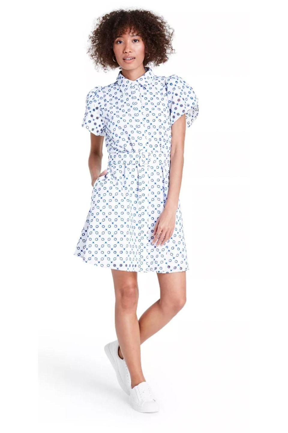 """<p><strong>ALEXIS for Target</strong></p><p>target.com</p><p><strong>$45.00</strong></p><p><a href=""""https://www.target.com/p/dot-tulip-sleeve-embroidered-shirtdress-alexis-for-target-white-blue/-/A-82020708"""" rel=""""nofollow noopener"""" target=""""_blank"""" data-ylk=""""slk:Shop Now"""" class=""""link rapid-noclick-resp"""">Shop Now</a></p>"""