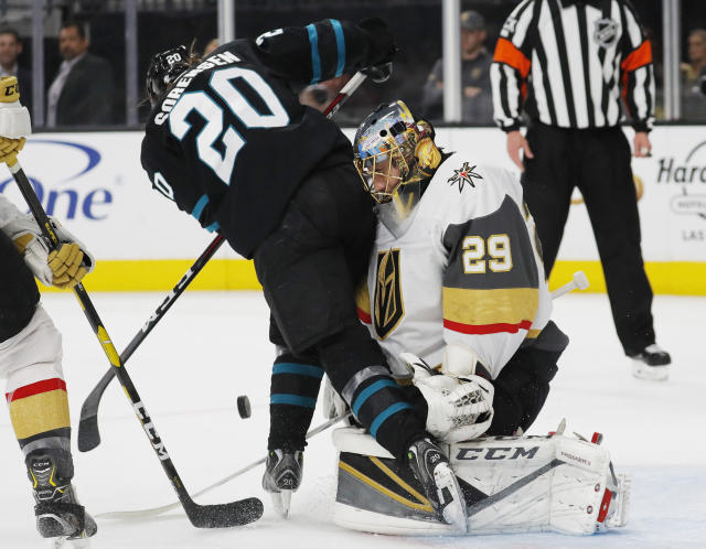 San Jose Sharks left wing Marcus Sorensen digs for the puck as Vegas Golden Knights goaltender Marc-Andre Fleury blocks a shot during the first period of an NHL hockey game Thursday, Jan. 10, 2019, in Las Vegas. (AP Photo/John Locher)