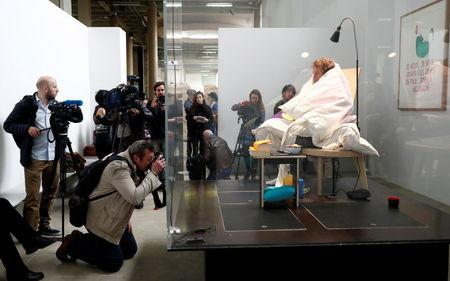 French artist Abraham Poincheval is seen in a vivarium on the first day of his performance in an attempt to incubate chicken eggs, which takes from 21 to 26 days, at the Palais de Tokyo Museum in Paris