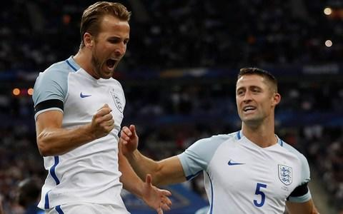 England's Harry Kane celebrates scoring their second goal and is embraced by Gary Cahill  - Credit: Action Images via Reuters / Lee Smith