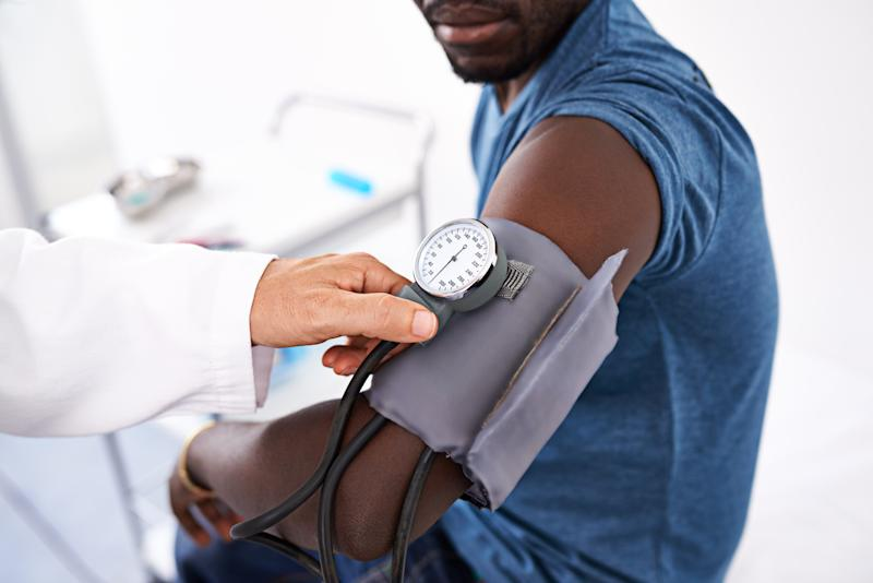 Cropped shot of a doctor measuring a patient's blood pressure
