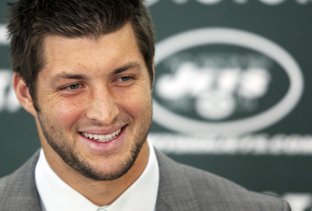 Tim Tebow holds his first news conference with the New York Jets, Monday, March 26, 2012, in Florham Park, N.J. Tebow, who led the Denver Broncos to the playoffs last year, was acquired in a trade Wednesday with Denver and will serve as the backup quarterback to Mark Sanchez. (AP Photo/Mark Lennihan)