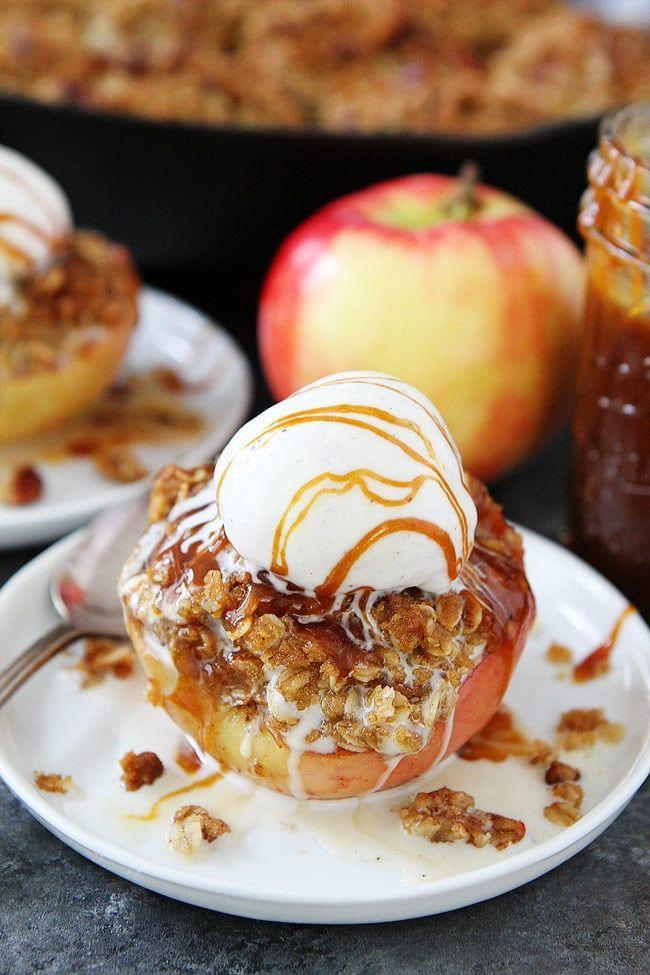 """<p>Warm baked apples are teeming with a brown butter cinnamon streusel topping that's hard to resist in this quick dessert. </p><p><a href=""""https://www.twopeasandtheirpod.com/cinnamon-streusel-baked-apples/"""" rel=""""nofollow noopener"""" target=""""_blank"""" data-ylk=""""slk:Get the recipe"""" class=""""link rapid-noclick-resp"""">Get the recipe</a>.</p>"""