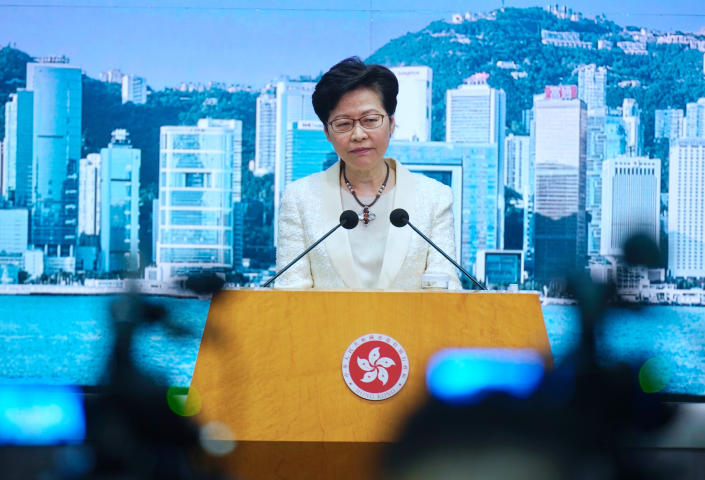 Hong Kong Chief Executive Carrie Lam listens to questions during a news conference in Hong Kong, Tuesday, May 11, 2021. Lam announced Hong Kong officials have dropped a plan to make it mandatory for foreign domestic workers to be vaccinated against the coronavirus, after the move drew criticism that it was discriminatory. (AP Photo/Vincent Yu)