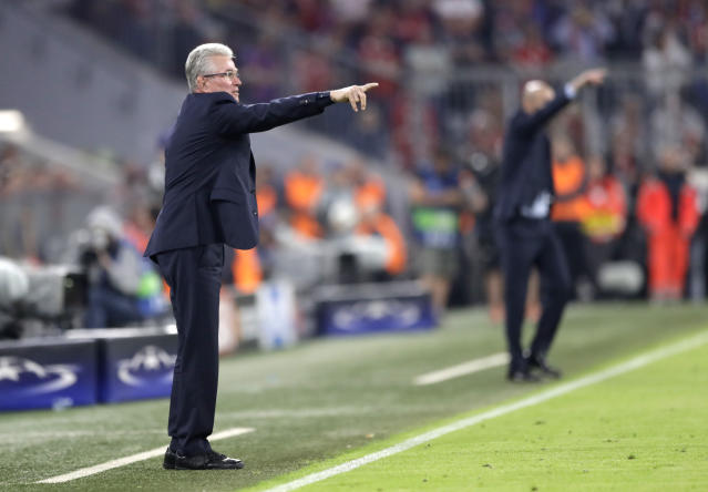 Bayern coach Jupp Heynckes, left, and Real Madrid coach Zinedine Zidane direct their players during the semifinal first leg soccer match between FC Bayern Munich and Real Madrid at the Allianz Arena stadium in Munich, Germany, Wednesday, April 25, 2018. (AP Photo/Matthias Schrader)