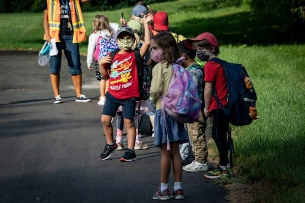 Students, parents and educators felt a heady mix of emotions this week as classes started again amid the COVID-19 pandemic.  (Evan Mitsui/CBC - image credit)