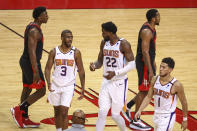Phoenix Suns guard Chris Paul (3) and center Deandre Ayton (22) talk during a timeout during the fourth quarter against the Houston Rockets during an NBA basketball game in Houston, Monday, April 5, 2021. (Troy Taormina/Pool Photo via AP)