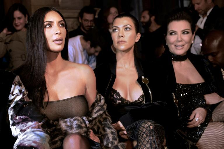 Kim Kardashian (left) later told police the robbers tied her up with plastic cables and adhesive tape, and placed her in the bathtub