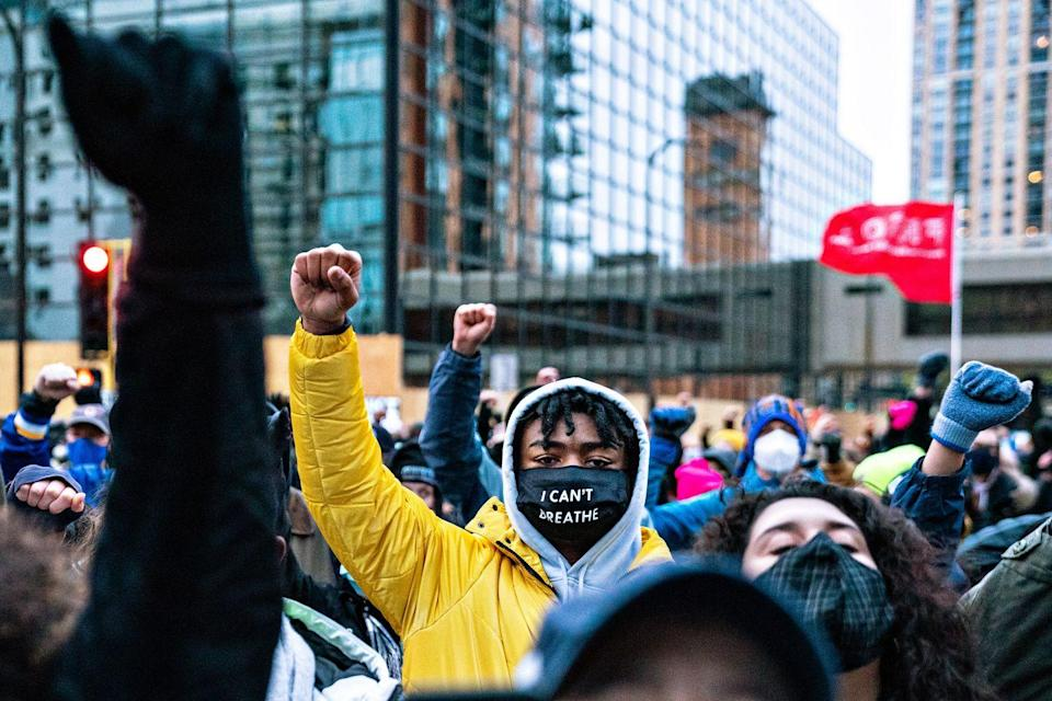 <p>Protesters hold their fist in the air at a rally in downtown Minneapolis near the courthouse on Monday, April 19 in Minneapolis.</p>