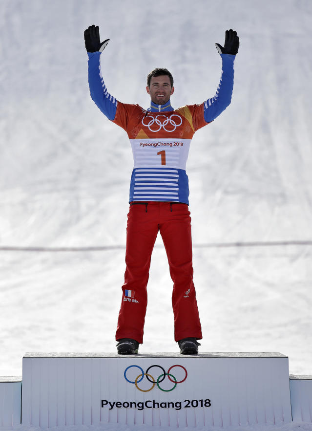 <p>Gold medal winner Pierre Vaultier, of France, celebrates after the men's snowboard cross final at Phoenix Snow Park at the 2018 Winter Olympics in Pyeongchang, South Korea, Thursday, Feb. 15, 2018. (AP Photo/Gregory Bull) </p>