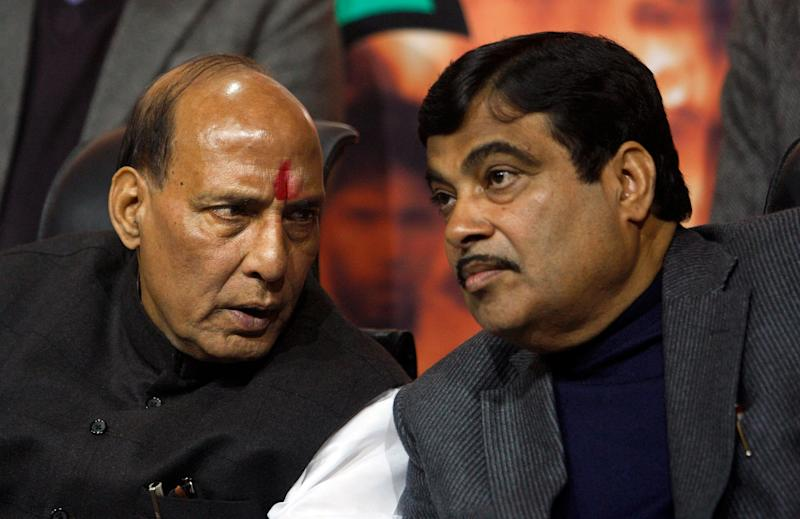 Newly elected President of India's main opposition Bharatiya Janata Party (BJP) Rajnath Singh, left, and outgoing party president Nitin Gadkari talk in New Delhi, India, Wednesday, Jan. 23, 2013. Singh was elected unopposed Wednesday morning. (AP Photo/Tsering Topgyal)