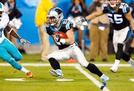 Nov 13, 2017; Charlotte, NC, USA; Carolina Panthers running back Christian McCaffrey (22) runs the ball during the first quarter against the Miami Dolphins at Bank of America Stadium. Jeremy Brevard-USA TODAY Sports