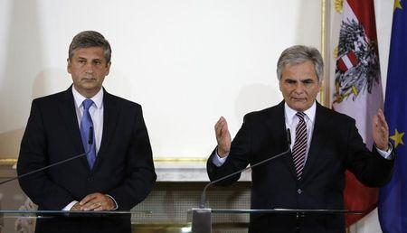Austrian Finance Minister Spindelegger and Chancellor Faymann address a news conference in Vienna