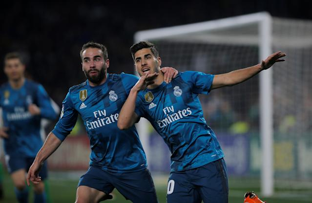 Soccer Football - La Liga Santander - Real Betis vs Real Madrid - Estadio Benito Villamarin, Seville, Spain - February 18, 2018 Real Madrid's Marco Asensio celebrates scoring their third goal with Dani Carvajal REUTERS/Jon Nazca