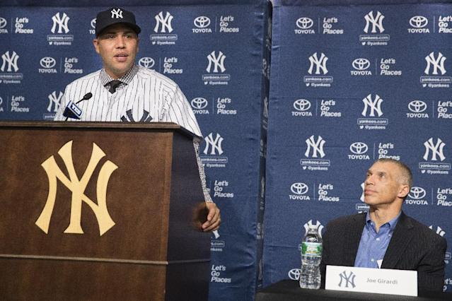 Carlos Beltran speaks as New York Yankees manager Joe Girardi looks on during a news conference at Yankees Stadium, Friday, Dec. 20, 2013, in New York. The former St. Louis Cardinals outfielder signed with the New York Yankees on a $45 million, three-year contract.(AP Photo/John Minchillo)