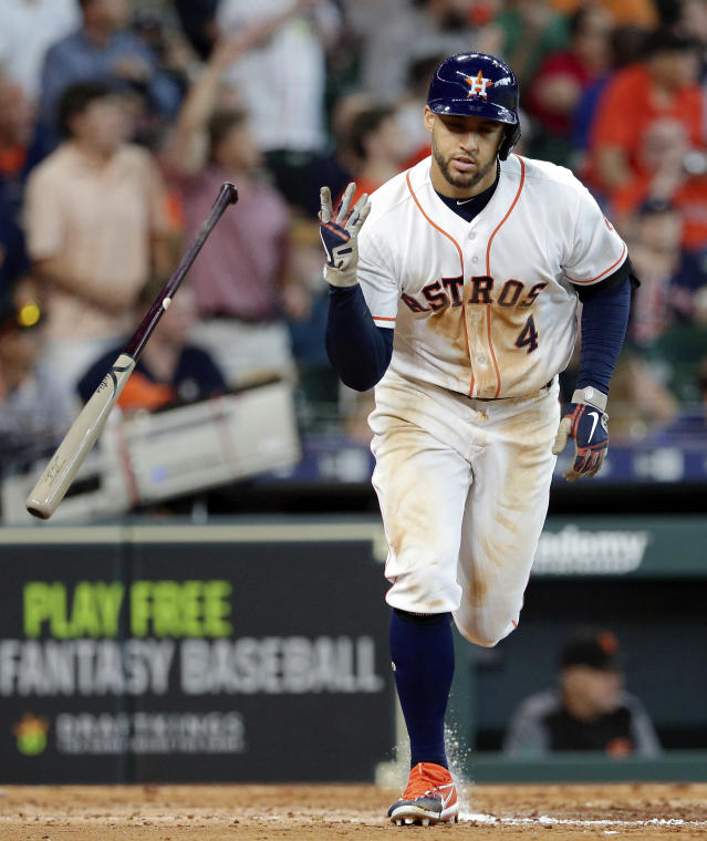 Houston Astros George Springer (4) tosses his bat to round the bases after hitting his two run home run during the fifth inning of a baseball game against the San Francisco Giants Wednesday, May 23, 2018, in Houston. (AP Photo/Michael Wyke)