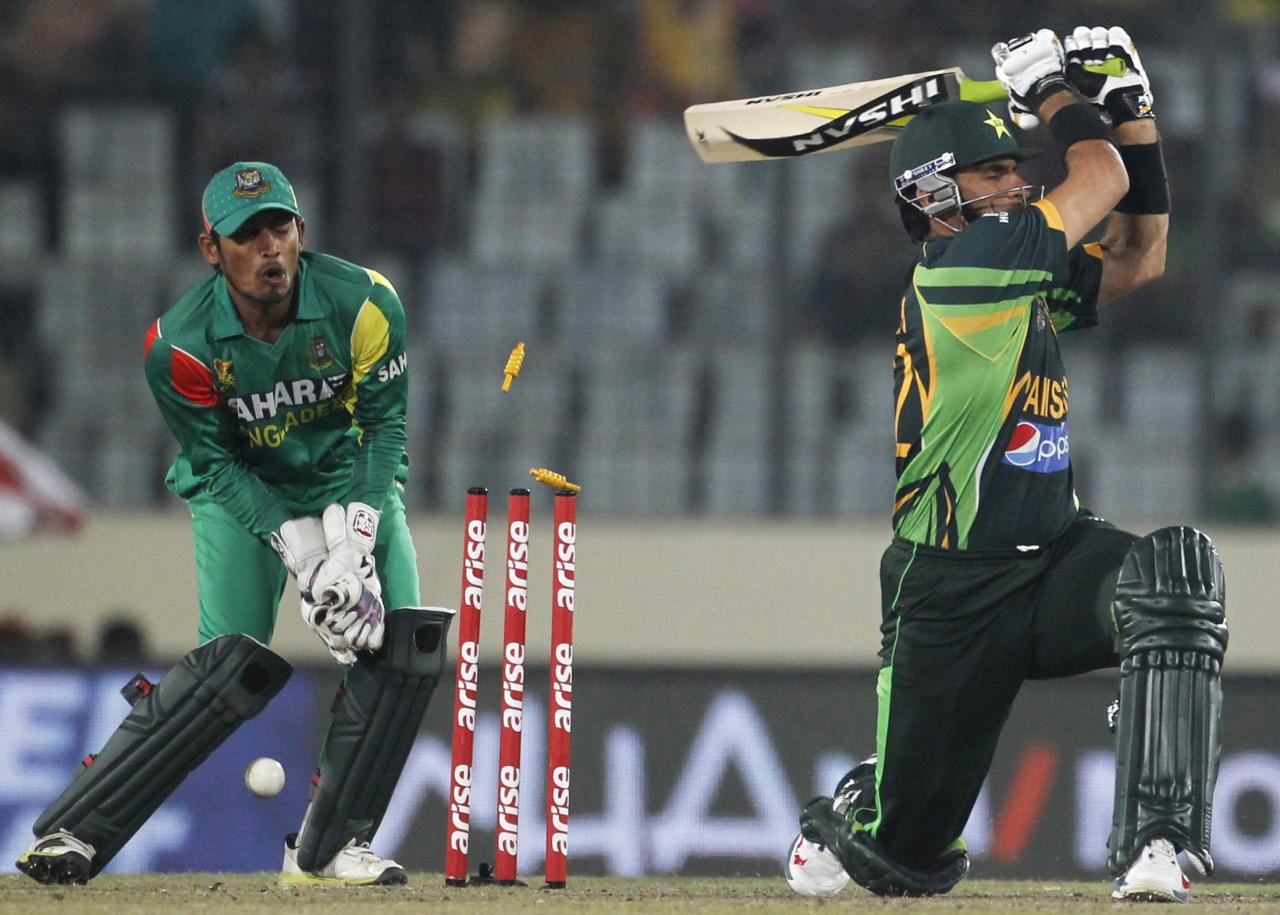 Pakistan's captain Misbah-ul-Haq is bowled out against Bangladesh during their one-day international (ODI) cricket match in Asia Cup 2014 in Dhaka March 4, 2014. REUTERS/Andrew Biraj (BANGLADESH - Tags: SPORT CRICKET)
