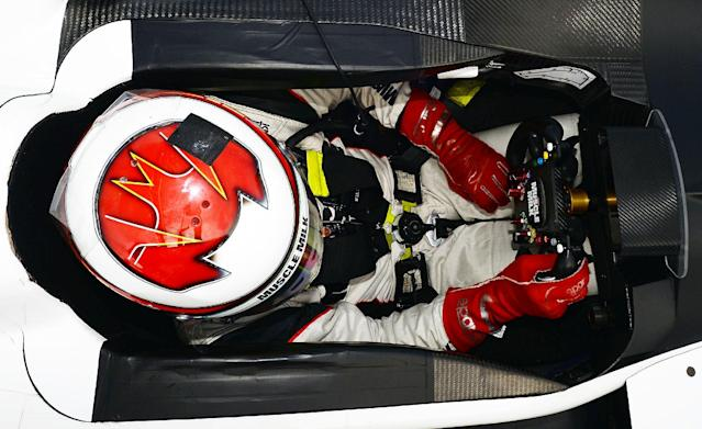 Lucas Luhr, of Germany, sits in his car during qualifying for the American Le Mans Series' Petit Le Mans auto race at Road Atlanta, Friday, Oct. 18, 2013, in Braselton, Ga. (AP Photo/Rainier Ehrhardt)