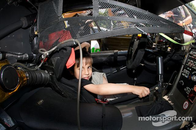 "2008: A young fan in the Corvette Racing Corvette C6.R <span class=""copyright"">Eric Gilbert</span>"