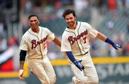 May 20, 2018; Atlanta, GA, USA; Atlanta Braves shortstop Dansby Swanson (7) reacts with third baseman Johan Camargo (17) after getting the game winning hit against the Miami Marlins during the ninth inning at SunTrust Park. Mandatory Credit: Dale Zanine-USA TODAY Sports