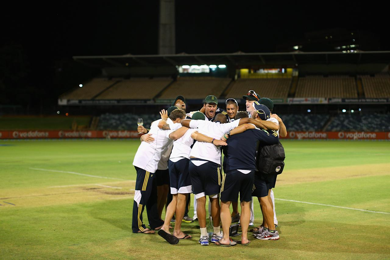 PERTH, AUSTRALIA - DECEMBER 03:  South African players sing together and celebrate on the wicket after defeating Australia and winning the series on day four of the Third Test Match between Australia and South Africa at WACA on December 3, 2012 in Perth, Australia.  (Photo by Cameron Spencer/Getty Images)