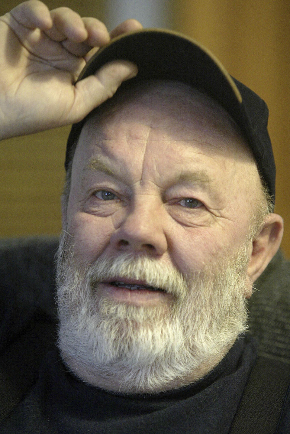 FILE - Writer Gary Paulsen appears at his Willow, Alaska, home on Feb. 10, 2005. Paulsen died Wednesday, Oct. 13, 2021 at age 82. (AP Photo/Al Grillo, File)