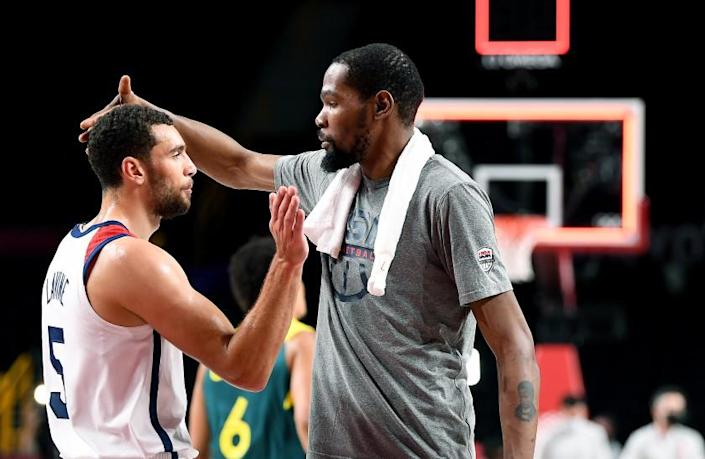 -TOKYO,JAPAN August 5, 2021: USA's Kevin Durant, left, celebrates with Zach LaVine after defeating Australia in a semi-final game against Australia at the 2020 Tokyo Olympics. (Wally Skalij /Los Angeles Times)