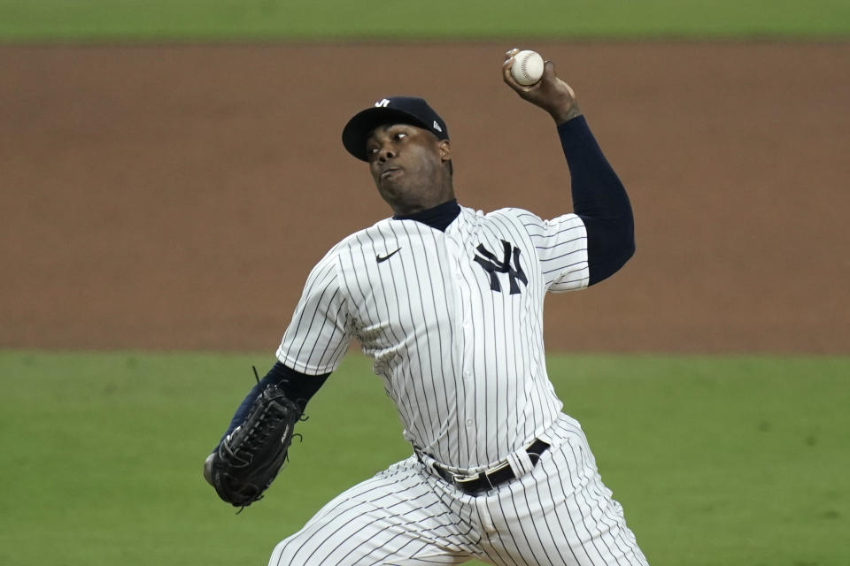 New York Yankees closing pitcher Aroldis Chapman throws against the Tampa Bay Rays during the ninth inning in Game 4 of a baseball American League Division Series Thursday, Oct. 8, 2020, in San Diego. The Yankees won 5-1. (AP Photo/Jae C. Hong)