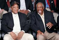 FILE PHOTO: Willie Mays (L) and Frank Robinson (R) talk at a photo session for the Major League Baseball players with over 500 career home runs before the MLB All-Star Game Home Run Derby in Houston July 12, 2004. Mays has 600 home runs and Robinson 586. REUTERS/Rick Wilking/File Photo