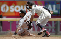 San Francisco Giants' LaMonte Wade Jr., left, steals second base past Atlanta Braves' Dansby Swanson in the third inning of a baseball game Sunday, Aug. 29, 2021, in Atlanta. (AP Photo/Ben Margot)