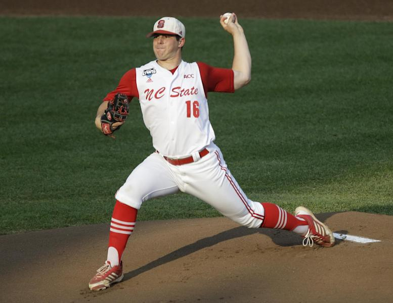 North Carolina State starting pitcher Carlos Rodon throws against North Carolina in the first inning of an NCAA College World Series elimination baseball game in Omaha, Neb., Thursday, June 20, 2013. (AP Photo/Nati Harnik)