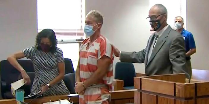 Barry Morphew stands in court