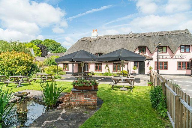 """<p>Home to thatched cottages and pubs, like <a href=""""https://go.redirectingat.com?id=127X1599956&url=https%3A%2F%2Fwww.booking.com%2Fhotel%2Fgb%2Fthe-anvil-inn.en-gb.html%3Faid%3D2070936%26label%3Ddorset-villages&sref=https%3A%2F%2Fwww.prima.co.uk%2Ftravel%2Fg35967807%2Fdorset-villages%2F"""" rel=""""nofollow noopener"""" target=""""_blank"""" data-ylk=""""slk:the Anvil Inn"""" class=""""link rapid-noclick-resp"""">the Anvil Inn</a>, Pimperne is surrounded by a patchwork of rolling green fields and quiet spots for woodland walks. </p><p>After stopping off for a G&T in the sunshine, stroll through the village to see well-kept houses with colourful floral displays – Pimperne won Best Large Village in the 2019 <a href=""""https://www.dorsetecho.co.uk/news/17942061.winners-dorsets-best-village-awards-2019/"""" rel=""""nofollow noopener"""" target=""""_blank"""" data-ylk=""""slk:Dorset's Best Village competition"""" class=""""link rapid-noclick-resp"""">Dorset's Best Village competition</a>. History buffs should keep an eye out for the ancient stone church, parts of which date all the way back to the time of William the Conqueror.</p><p><strong>Where to stay: </strong>For a relaxing break just 20 minutes from Pimperne, <a href=""""https://go.redirectingat.com?id=127X1599956&url=https%3A%2F%2Fwww.booking.com%2Fhotel%2Fgb%2Fplumber-manor.en-gb.html%3Faid%3D2070936%26label%3Ddorset-villages&sref=https%3A%2F%2Fwww.prima.co.uk%2Ftravel%2Fg35967807%2Fdorset-villages%2F"""" rel=""""nofollow noopener"""" target=""""_blank"""" data-ylk=""""slk:Plumber Manor"""" class=""""link rapid-noclick-resp"""">Plumber Manor</a> is a handsome, family-owned country house hotel with beautiful gardens and a relaxed but traditional feel. </p><p><a class=""""link rapid-noclick-resp"""" href=""""https://go.redirectingat.com?id=127X1599956&url=https%3A%2F%2Fwww.booking.com%2Fhotel%2Fgb%2Fthe-anvil-inn.en-gb.html%3Faid%3D2070936%26label%3Ddorset-villages&sref=https%3A%2F%2Fwww.prima.co.uk%2Ftravel%2Fg35967807%2Fdorset-villages%2F"""" rel=""""nofollow noopener"""" target=""""_blank"""" data-ylk=""""slk:CHECK AVAI"""