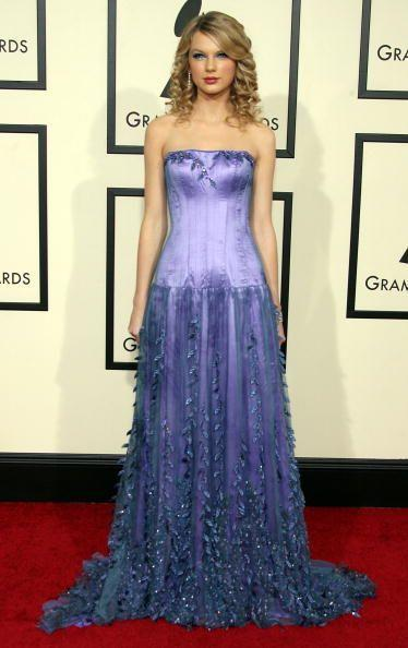 <p>Taylor won the 'Best New Artist' award at the 2008 Grammys, her first time at the prestigious event. </p><p>She was classic country Taylor in this ensemble. Ringlet curls, check. Floor length strapless gown, check. Icy eye make up and red blusher, check! All was well with the world back in '08.</p>