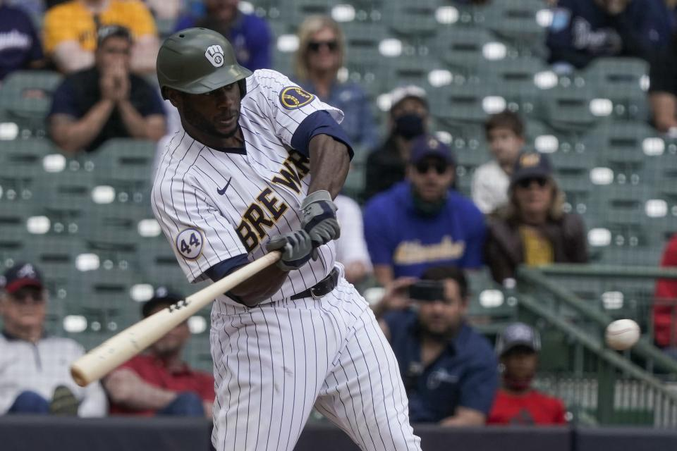 Milwaukee Brewers' Lorenzo Cain hits a two-run scoring single during the seventh inning of a baseball game against the Atlanta Braves Sunday, May 16, 2021, in Milwaukee. (AP Photo/Morry Gash)