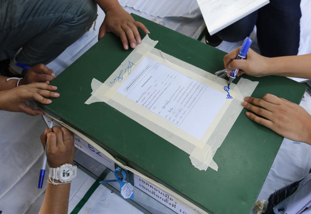 Volunteers prepare ballot boxes ahead of Sunday's general elections Bangkok, Thailand, Saturday, March 23, 2019. The nation's first general election since the military seized power in a 2014 coup is scheduled to be held on March 24. (AP Photo/Sakchai Lalit)