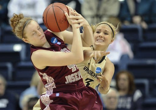 Saint Joseph's Sarah Fairbanks, left, is pressured by Vanderbilt's Heather Bowe, right, during a first-round game in the women's NCAA college basketball tournament in Storrs, Conn., Saturday, March 23, 2013. (AP Photo/Jessica Hill)