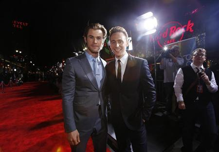 "Cast members Hemsworth and Hiddleston pose at the premiere of ""Thor: The Dark World"" in Hollywood"