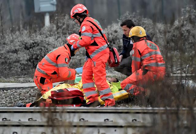 <p>Rescue workers help an injured person on a stretcher after two trains derailed in Pioltello, on the outskirts of Milan, Italy, Jan. 25, 2018. (Photo: Stringer/Reuters) </p>