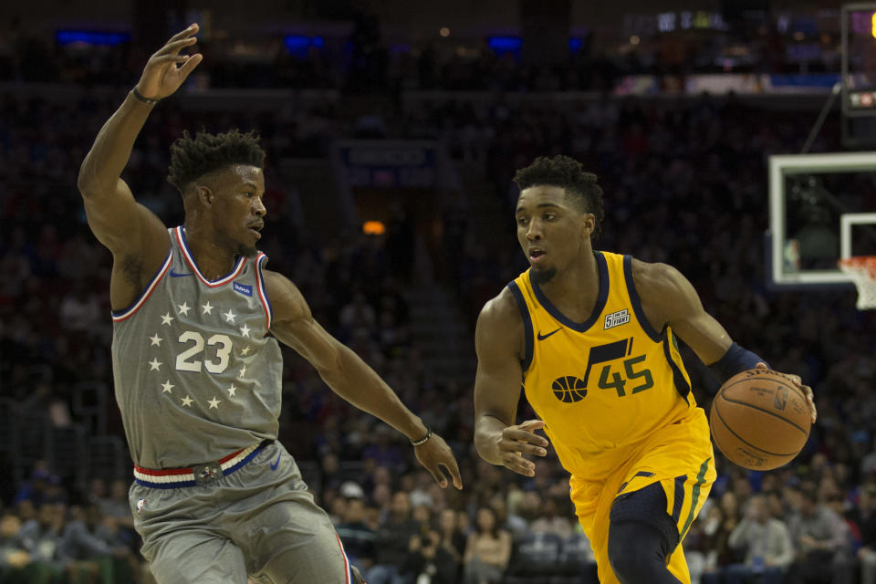 Donovan Mitchell drives on Jimmy Butler during the Utah Jazz's loss to the Philadelphia 76ers. (Getty)