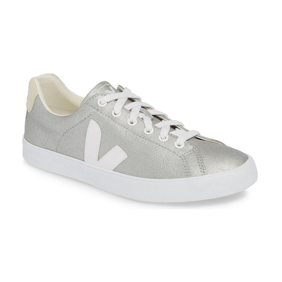 """<p><strong>Veja</strong></p><p>thewhitecompany.com</p><p><strong>$95.00</strong></p><p><a href=""""https://go.redirectingat.com?id=74968X1596630&url=https%3A%2F%2Fwww.thewhitecompany.com%2Fus%2FVeja-Esplar-Canvas-Sneakers%2Fp%2FVECCT&sref=https%3A%2F%2Fwww.bestproducts.com%2Flifestyle%2Fg33823101%2F25th-wedding-anniversary-gifts%2F"""" rel=""""nofollow noopener"""" target=""""_blank"""" data-ylk=""""slk:Shop Now"""" class=""""link rapid-noclick-resp"""">Shop Now</a></p><p>Veja's sustainable leather sneakers have probably been on her wish list ever since they were worn by <a href=""""https://www.harpersbazaar.com/celebrity/latest/a24015441/meghan-markle-white-veja-sneakers-royal-tour-australia-shop/"""" rel=""""nofollow noopener"""" target=""""_blank"""" data-ylk=""""slk:Meghan Markle"""" class=""""link rapid-noclick-resp"""">Meghan Markle</a>. This sleek, silvery pair is just as trendy as her <a href=""""https://www.bestproducts.com/fashion/g1126/white-sneakers-for-women/"""" rel=""""nofollow noopener"""" target=""""_blank"""" data-ylk=""""slk:classic white kicks"""" class=""""link rapid-noclick-resp"""">classic white kicks</a>, but gives a nod to your special occasion. </p>"""