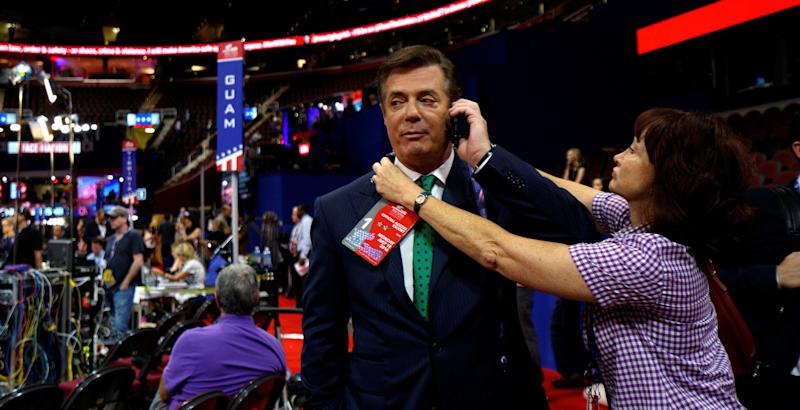 Kathleen Manafort tries to put a credential on her husband, Paul Manafort, at the Republican National Convention in Cleveland, July 17, 2016.