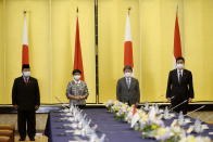 Indonesian Defense Minister Prabowo Subianto, left, Indonesian Foreign Minister Retno Marsudi, center left, Toshimitsu Motegi, Japan's foreign minister, center right, and Japanese Defense Minister Kishi Nobuo, right, pose for the photo at the start of the two-plus-two Foreign and Defense Ministers meeting between Japan and Indonesia Tuesday, March 30, 2021 at the Iikura Guesthouse of the Foreign Ministry in Tokyo, Japan.(David Mareuil/Pool Photo via AP)