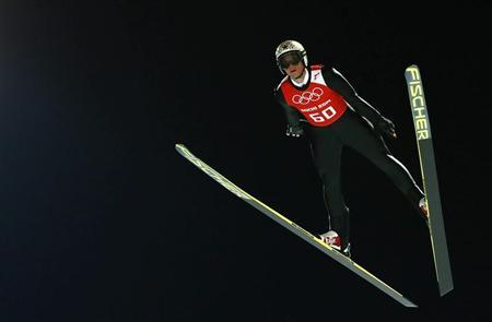 Austria's Morgenstern soars through the air during the men's ski jumping individual normal hill training event of the Sochi 2014 Winter Olympic Games in Rosa Khutor