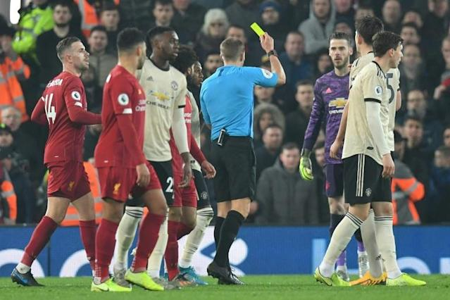 Manchester United have been charged over the conduct of their players in the 2-0 defeat by Liverpool which saw Spanish goalkeeper David de Gea booked (AFP Photo/Paul ELLIS)